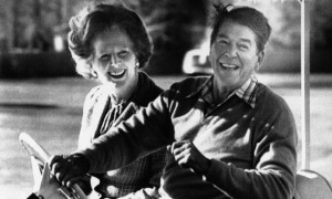 president-ronald-reagan-and-british-prime-minister-margaret-thatcher-smile-as-they-ride-an-electric